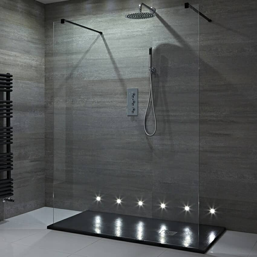 LED lit walk in shower area with floor level lights and black shower tray