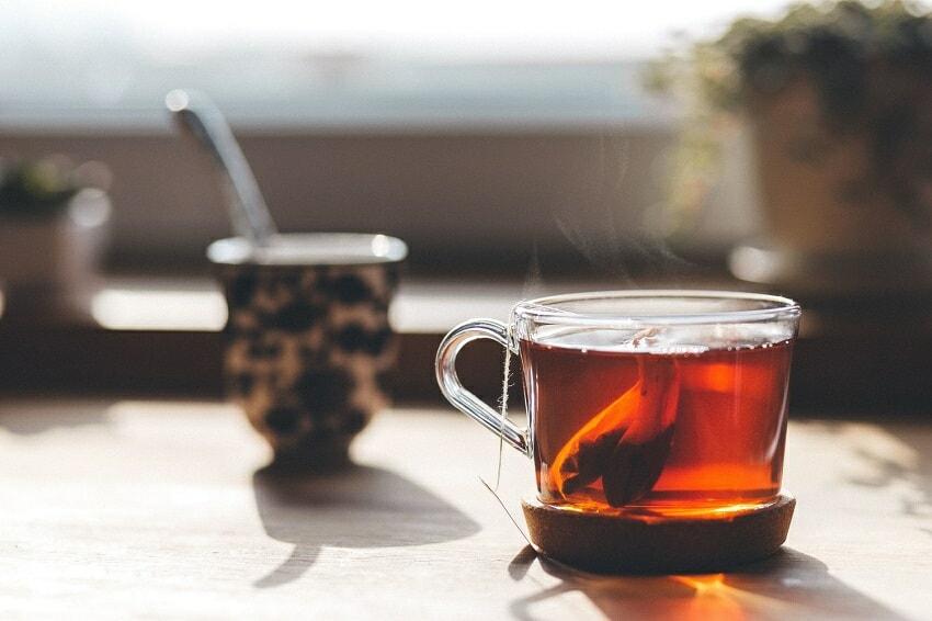 Glass tea cup with hot tea