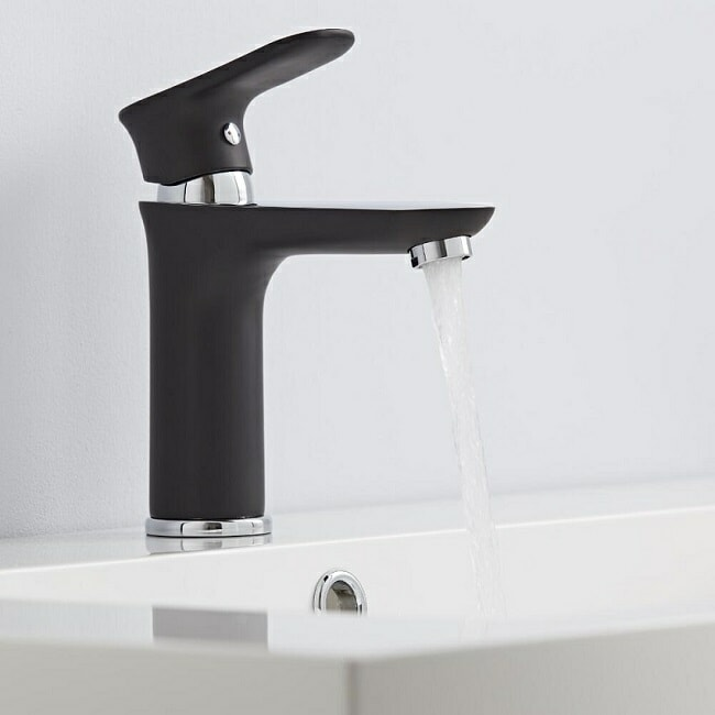 Black and chrome designer basin tap