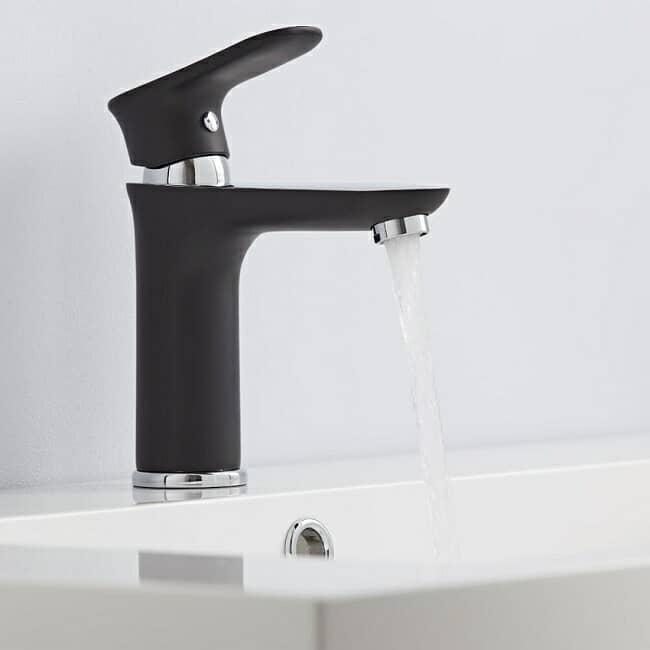 Black and chrome designer basin tap