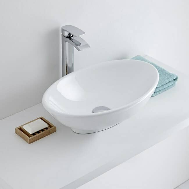 white oval counter-top basin with tall counter-top monobloc tap