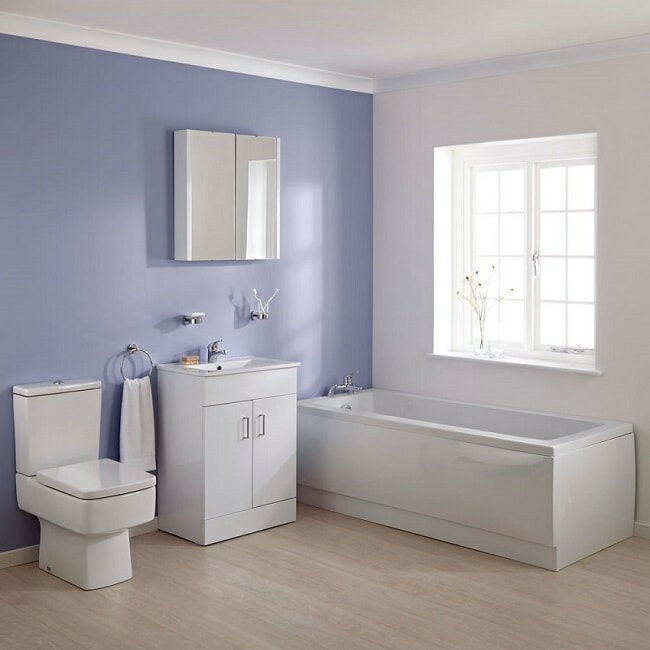 White rectangular bathroom suite in purple and white bathroom with window
