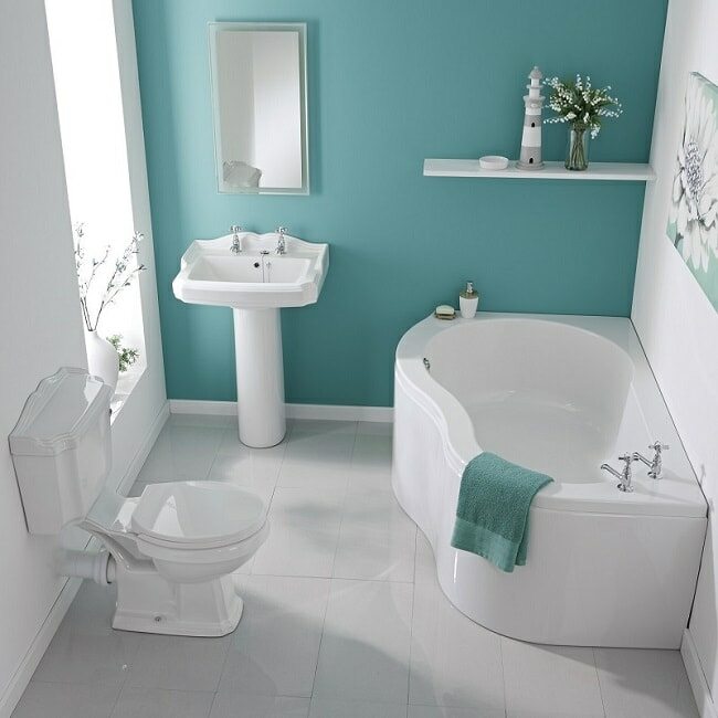 modern-bathroom-suite with P shaped corner bath, pedestal sink and traditional toilet