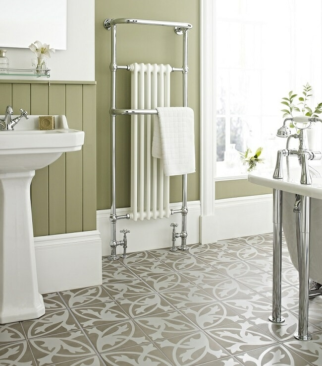 statement-bathroom-tiled floor with traditional bathroom furniture and radiator