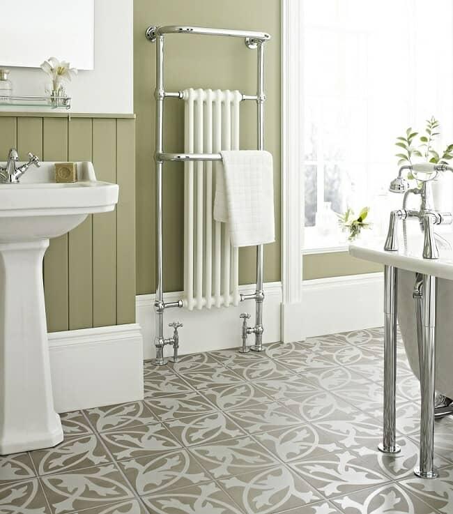statement-bathroom-tiled floor with traditional bathroom furniture and radiator