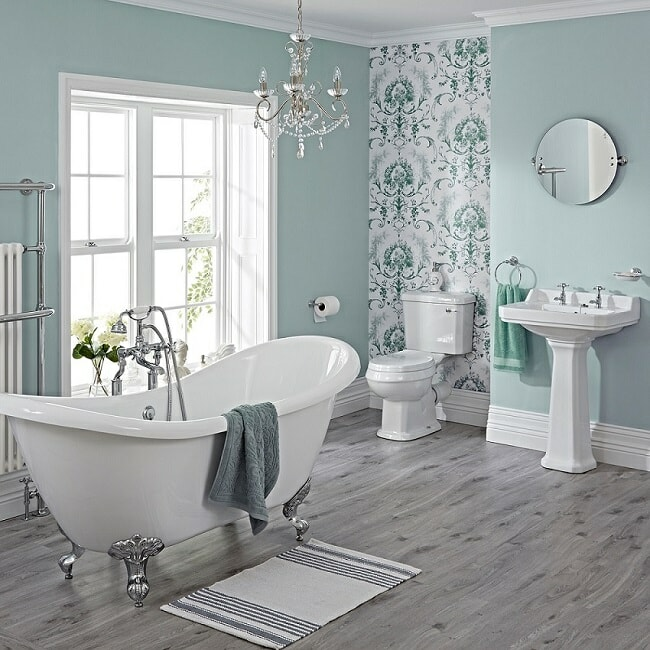 traditional bathroom with freestanding bath, toilet and basin