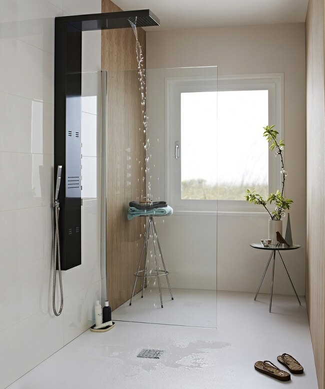 modern black shower tower in wet-room with glass screen