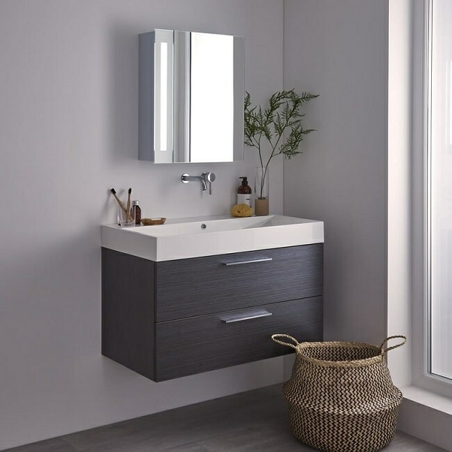 mirrored-bathroom-cabinet with vanity unit and wall mounted tap