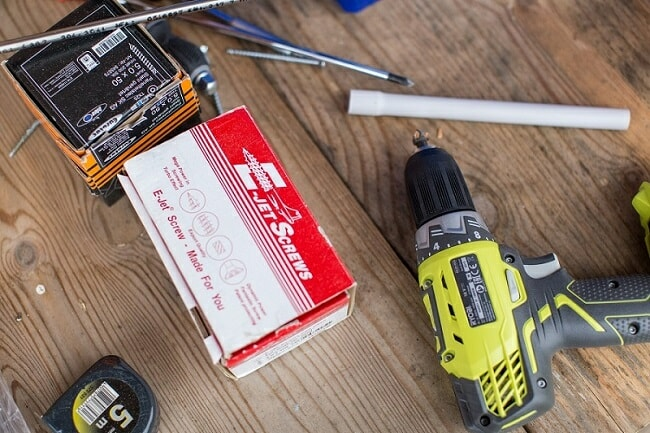 screws, electric drill, and tools