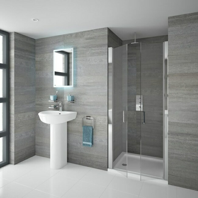 Bathroom with recessed shower with frameless hinged double doors and white square shower tray