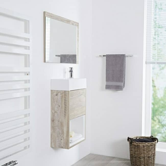 White cloakroom with small wall hung cloakroom vanity basin and tap