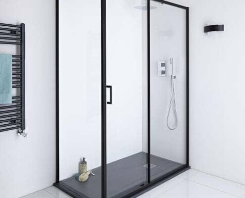 Black framed sliding shower door enclosure with black slate shower tray