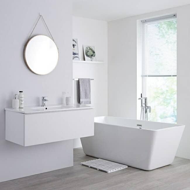 white vanity unit and bath