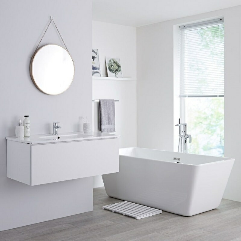 White bathroom vanity unit suite with freestanding bath