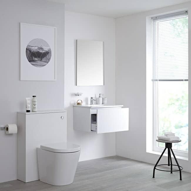 white vanity unit and wc unit