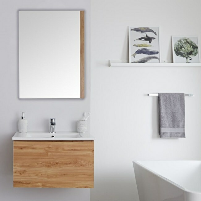 rectangular bathroom mirror with wall mounted vanity unit with wooden accents