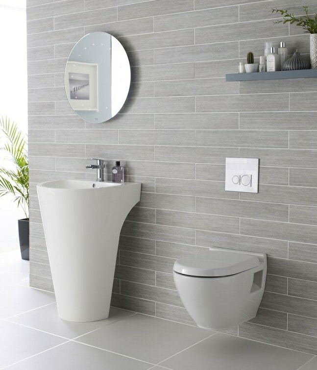 Wall hung toilet and designer basin set in modern bathroom