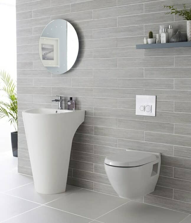 Wall hung toilet and designer basin set in modern bathroom