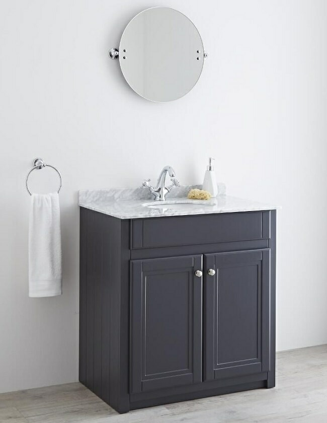 round bathroom mirror with anthracite floor mounted vanity unit with marble counter top