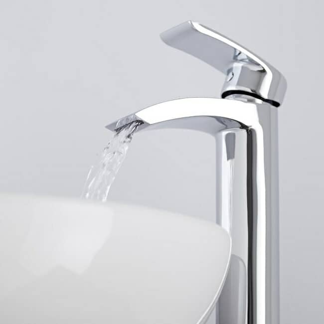 chrome high rise basin tap with water coming out of the spout