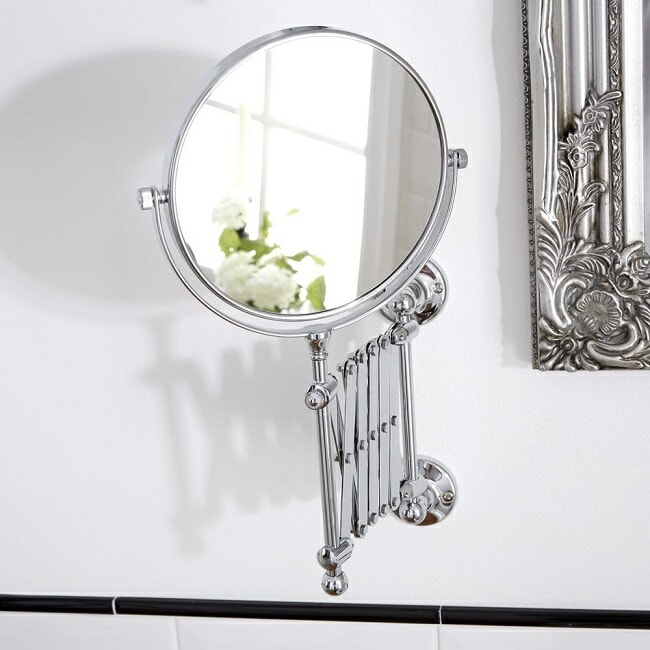 round shaving mirror with extendable scissor arm in chrome