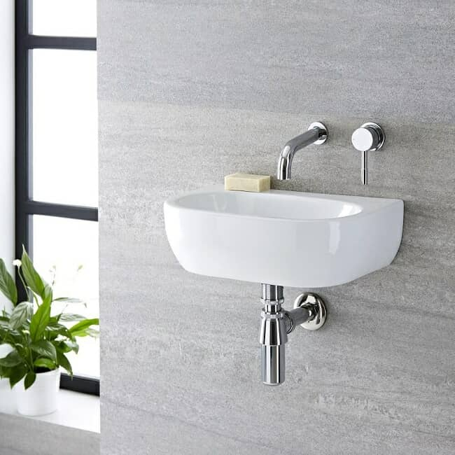 wall hung cloakroom basin with wall mounted tap