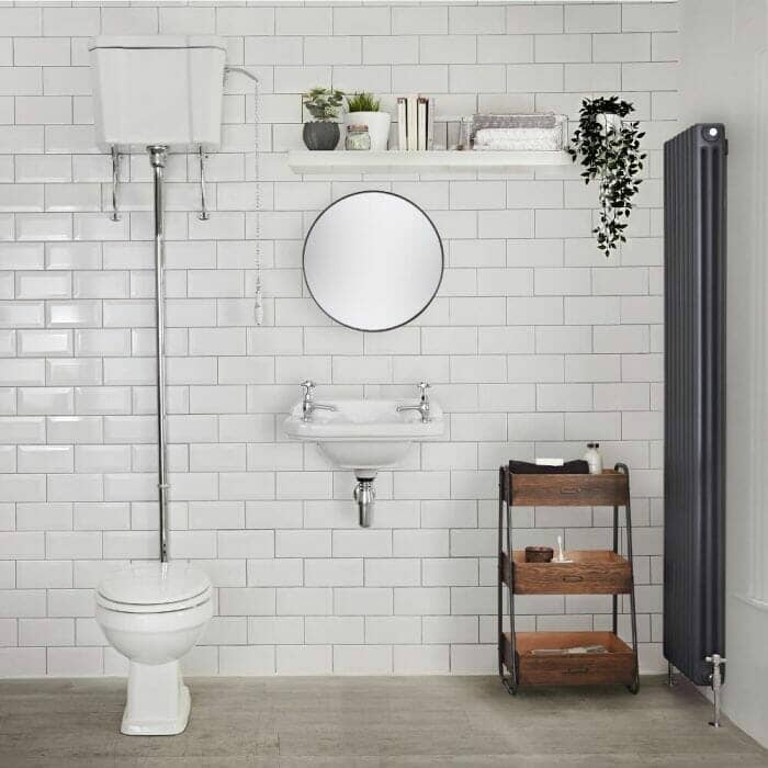 Traditional Toilet in a period look bathroom with a radiator