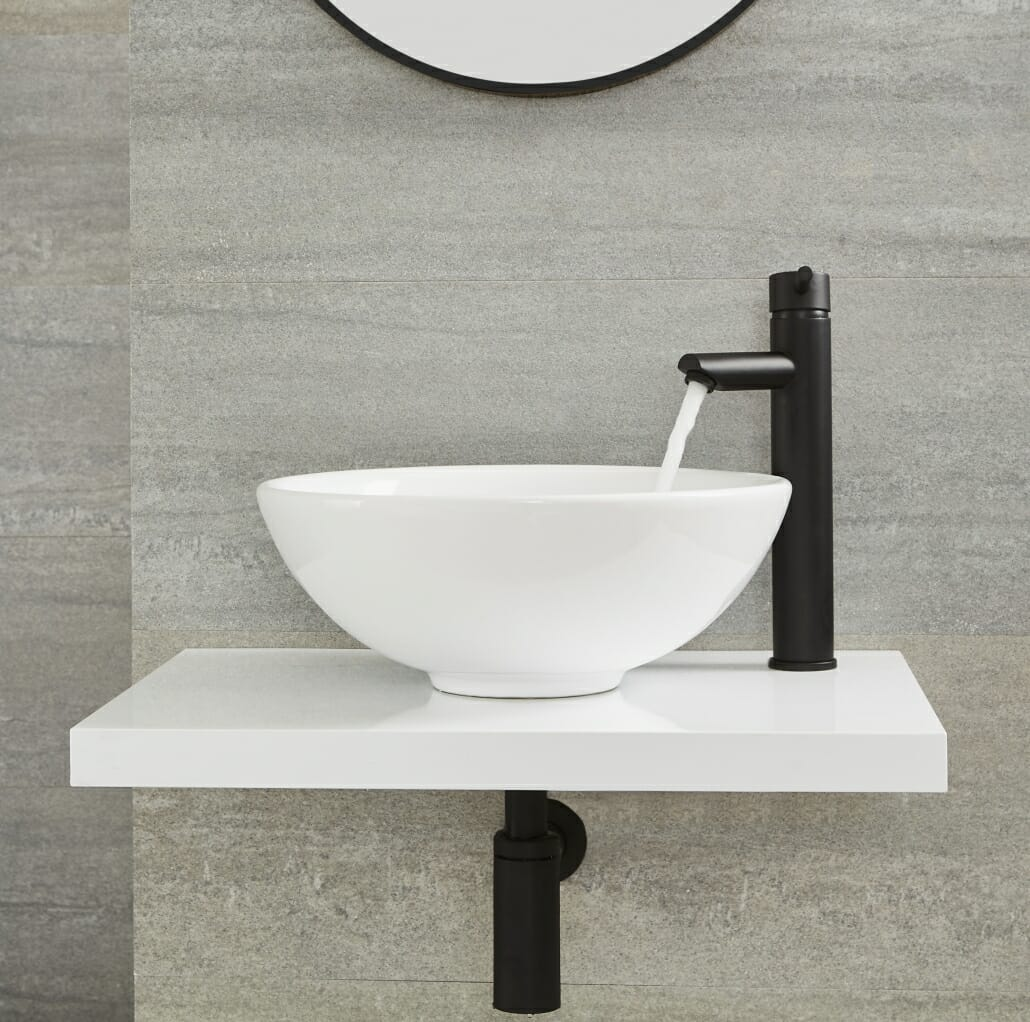 Milano Nero tall deck mounted basin tap in operation