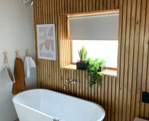 scandi style bathroom with freestanding bath