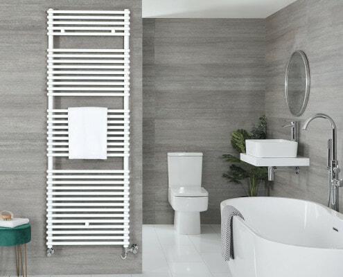 a white towel rail in a grey bathroom next to a bath