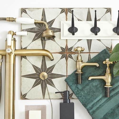 Scandi bathroom moodboard showing black and gold brassware on a tiled background