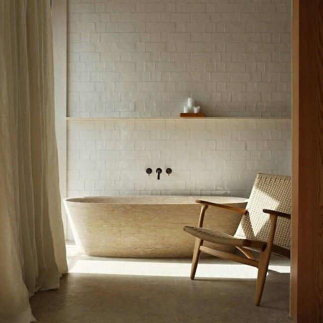 hans wegner chair in a scandinavian style bathroom