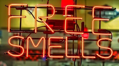 the words free smells written in a neon sign