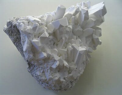a close up of borax crystals on a white background