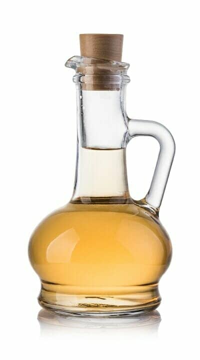 a bottle of vinegar on a white background