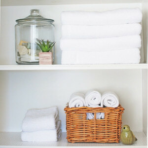 Towels on shelving in bathroom alcove