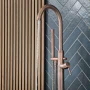 brushed copper freestanding bath tap