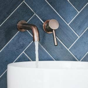 brushed copper wall mounted tap