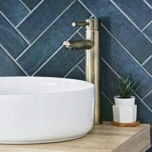 A Milano Clarus basin tap in a cottagecore bathroom vanity space