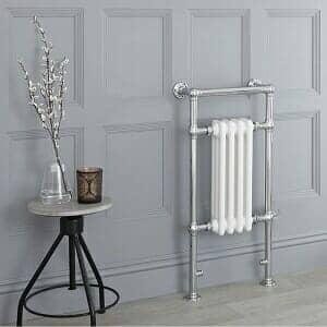 A Milano Elizabeth towel radiator in a cottageocre bathroom space