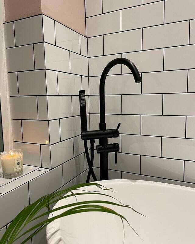 Freestanding bath tap