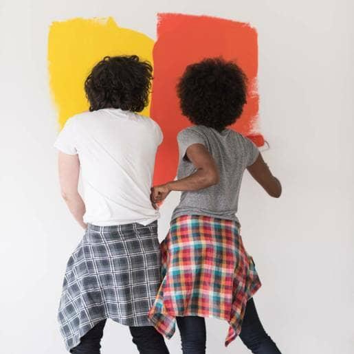 Couple painting bathroom walls